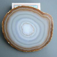 Радиально-кольцевое строение  минералов (халцедон-агат)